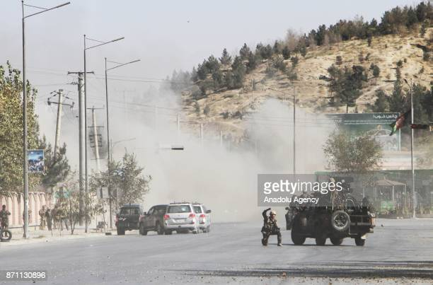 Afghan security officials take positions near the scene of an attack by armed men on Shamshad TV station in Kabul Afghanistan 07 November 2017 A...