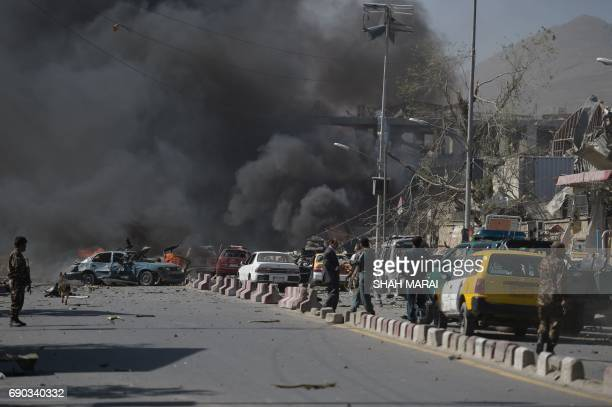 Afghan security personnel are seen at the site of a car bomb attack in Kabul on May 31 2017 At least 40 people were killed or wounded on May 31 as a...