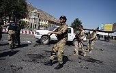Afghan security personnel arrive after a suicide attack that targeted crowds of minority Shiite Hazaras during a demonstration at the Deh Mazang...