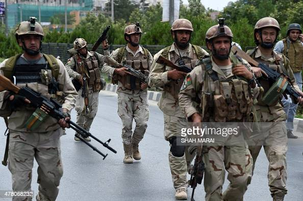 Afghan security personnel arrive at the site of an attack in front of The Parliament Building in Kabul on June 22 2015 Taliban militants attacked the...