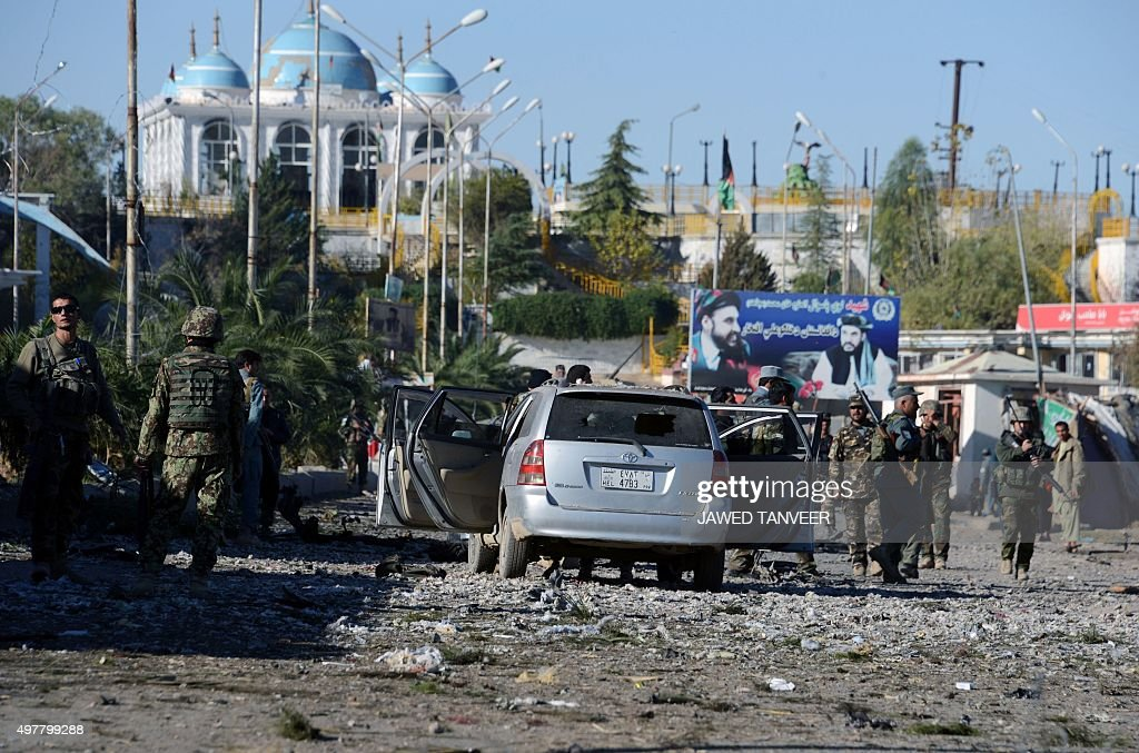 Afghan security personnel gather at the site of a Taliban suicide attack following clashes in Arghandab district of Kandahar province Taliban gunmen...