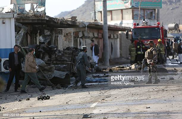 Afghan security personnel inspect the site of a suicide attack in Kabul Afghanistan April 10 2015 A suicide bomber in a car targeted armored vehicles...