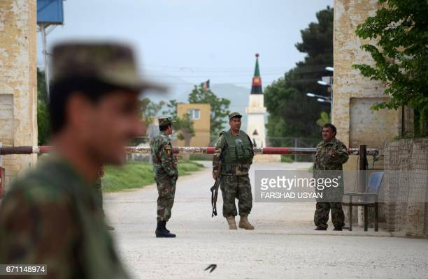 Afghan security personnel keep watch near the site of an ongoing attack on an army compound in Dihdadi District of Balkh province on April 21 2017 At...
