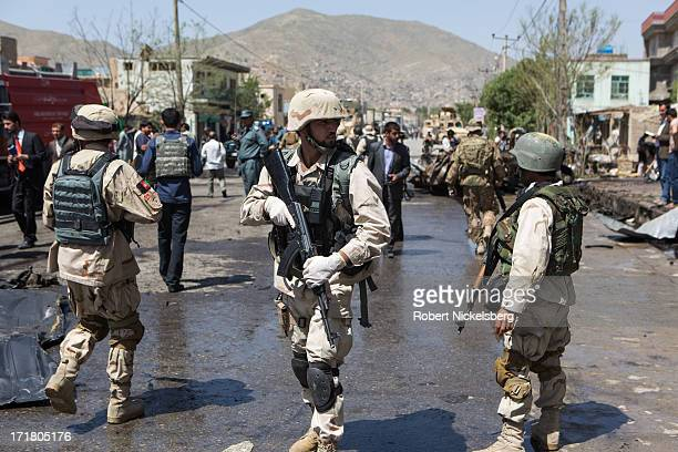 Afghan security personnel monitor crowds after a suicide car bomb explosion May 16 2013 in Kabul Afghanistan Sixteen people were killed in the attack...
