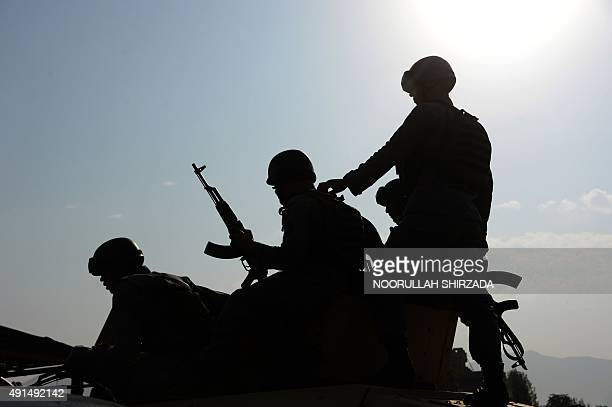 Afghan security personnel on a military vehicle at the site of an attack by Taliban militants in Kabul on October 6 2015 On the evening of October 5...