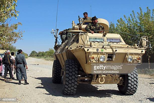 Afghan security personnel patrol along a street in Lashkar Gah capital of Helmand province on October 21 2015 Panicked residents fled the capital of...