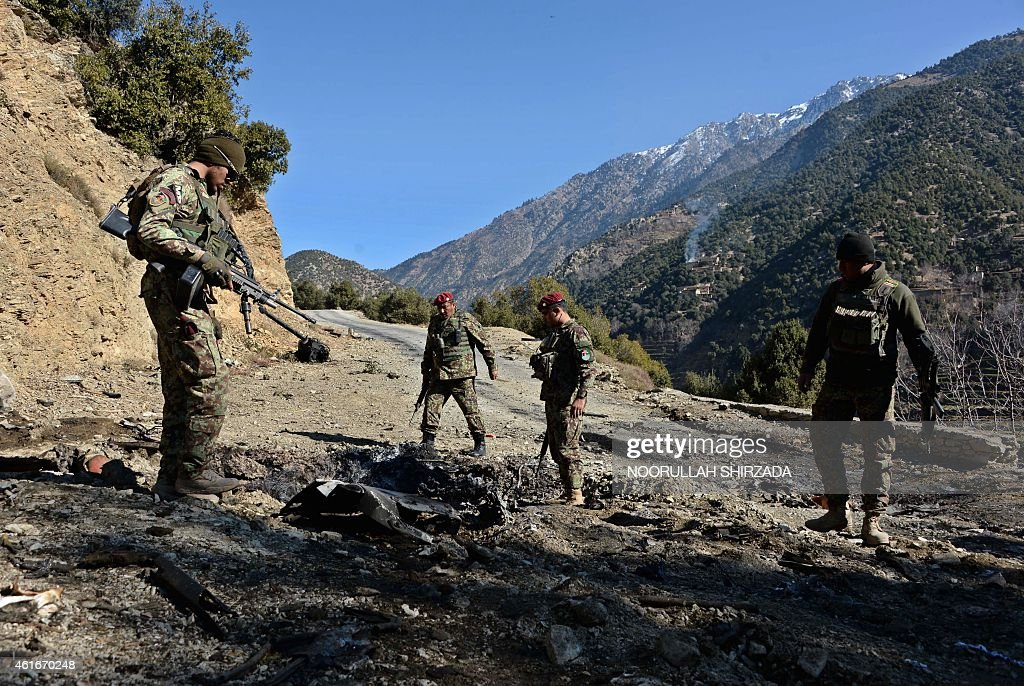 Afghan security personnel patrol during an ongoing antiTaliban operation in Dangam district near the PakistanAfghanistan border in eastern Kunar...