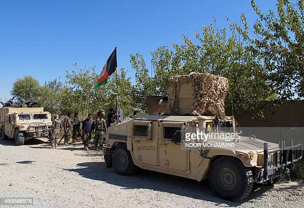 Afghan security personnel patrol in Lashkar Gah capital of Helmand province on October 21 2015 Panicked residents fled the capital of the opiumrich...