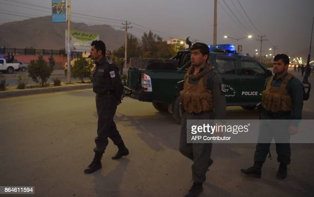 Afghan security personnel patrol near the site of a suicide bomb attack near the Marshal Fahim military academy base in Kabul on October 21 2017 A...