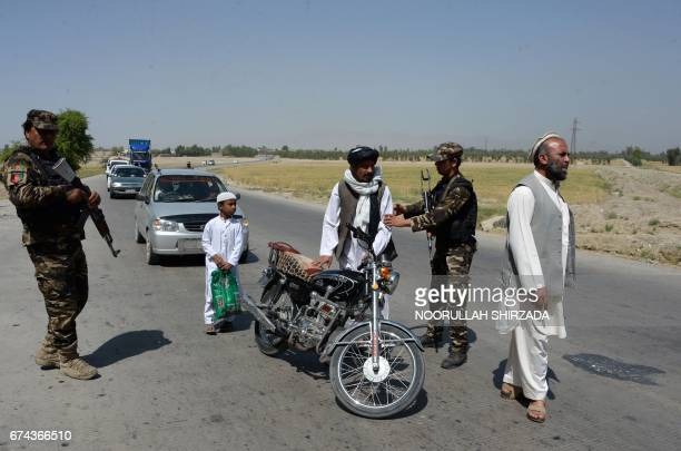 Afghan security personnel search travellers at a checkpoint on the outskirts of Jalalabad on April 28 2017 Two US troops were killed and one was...