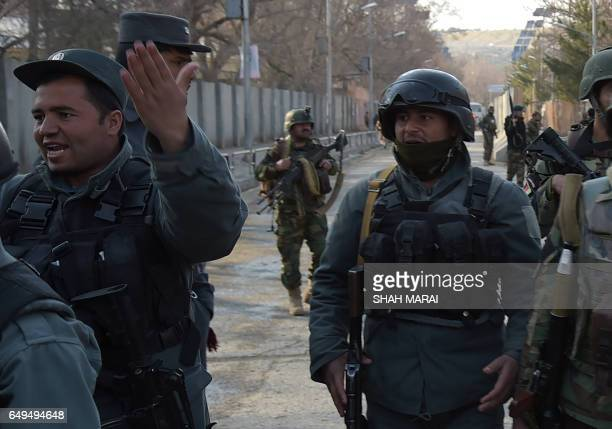 Afghan security personnel stand guard in front of the main gate of a military hospital in Kabul on March 8 after a deadly sixhour attack claimed by...