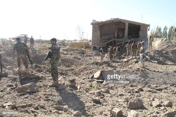 Afghan security personnel walk at the site of a suicide attack at a police training centre in Gardez capital of Paktia province on October 17 2017...