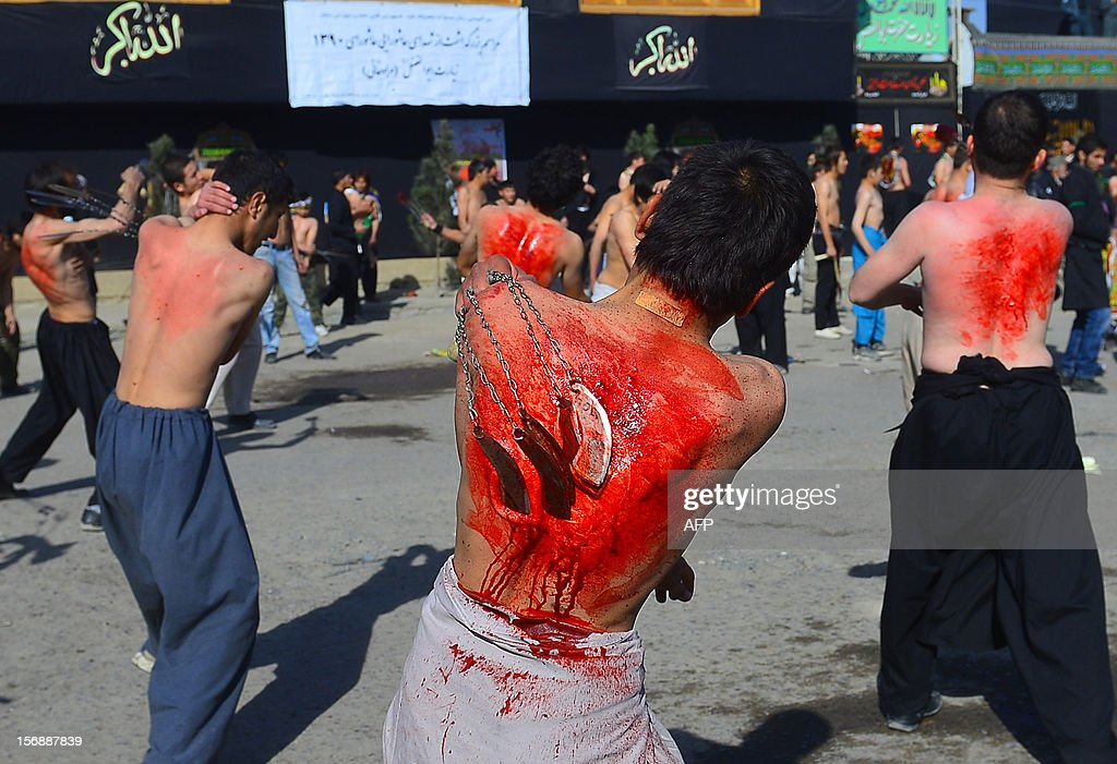 Afghan Shiite Muslim devotees beat themselves with chains and blades in a ritual marking Ashura in front of The Abul Fazel shrine in Kabul on November 24, 2012. In a brave gesture of defiance against suicide bombers, Afghanistan's 'girl-in-green' has revisited the scene of a Shiite Muslim holy-day massacre that made her image world famous. Tarana Akbari, now 13, was pictured screaming in horror among piles of bodies moments after a suicide bomber killed 80 people at last year's Ashura day ceremonies at a Shiite shrine in Kabul. AFP PHOTO/Massoud HOSSAINI