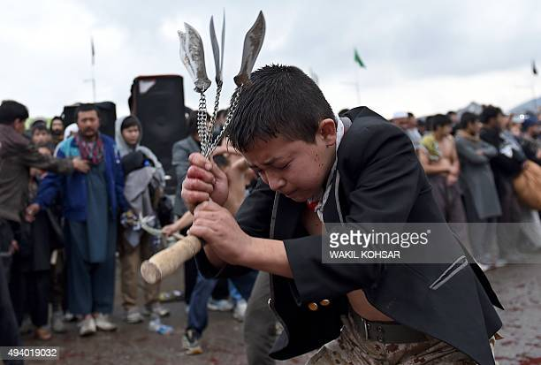 Afghan Shiite Muslim devotees beat themselves with chains and blades as part of a selfflagellation ritual during Ashura commemorations in front of...