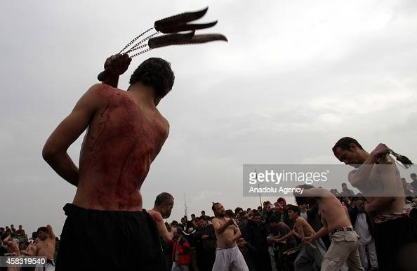 Afghan Shiite Muslim devotees flagellate themselves during a morning procession marking the day of Ashura in Kabul Afghanistan on November 3 2014...