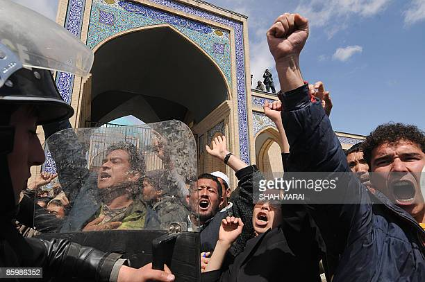 Afghan Shiite Muslims shout during a demonstration in Kabul on April 15 2009 A few dozen Afghans protesting a law said to impose Talibanstyle...