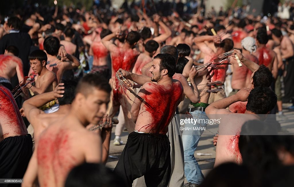 Afghan Shiites devotees beat themselves with chains and blades during commemorations ahead of the Day of Ashura in Kabul on October 30 2014 Ashura...