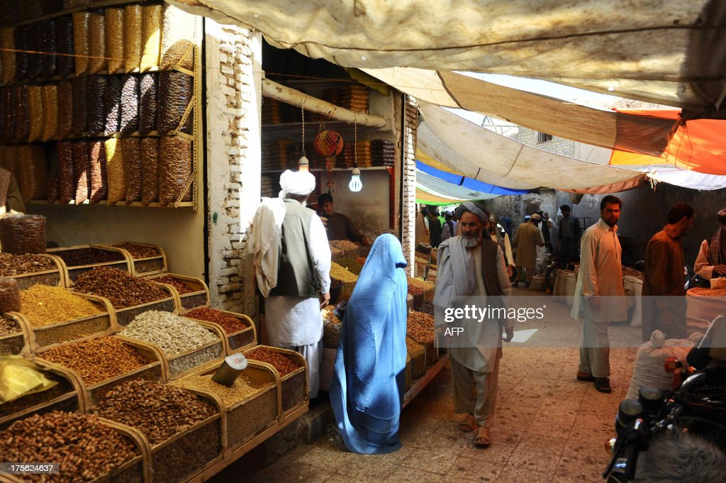Afghan shoppers buy dry fruits and sweets for the Eid festival, which marks the end of the Muslim holy month of Ramadan, at a market in Herat on August 5, 2013. Afghan Muslims, like millions of Muslims around the world, are observing the holy month of Ramadan - a month of fasting and spiritual purity during which they refrain from eating, drinking or sex from dawn until dusk. AFP PHOTO/ Aref KARIMI