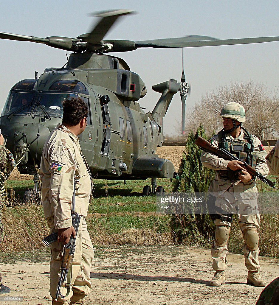 Afghan soldiers keep watch as a helicopter lands in Helmand province during the third day of joint Operation Moshtarak on February 15 2010 The Afghan...