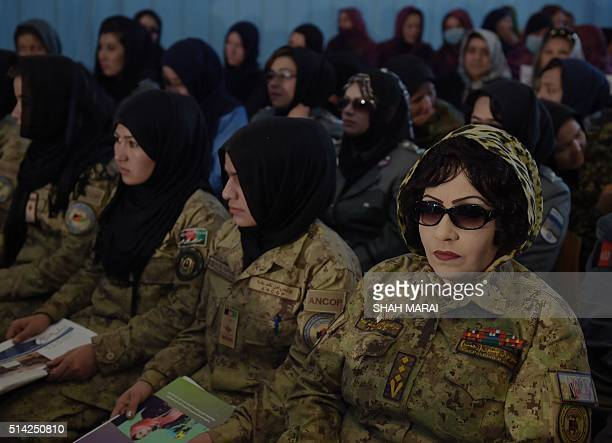 Afghan soldiers look on during an event to mark International Women's Day at the Amani High School in Kabul on March 8 2016 AFP PHOTO / SHAH Marai...