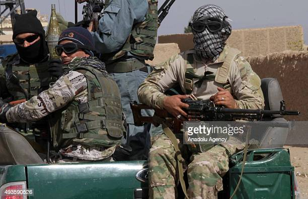 Afghan soldiers patrol after the Afghan security forces clashed with the Taliban militants in the Guryan district of Herat Afghanistan on October 21...