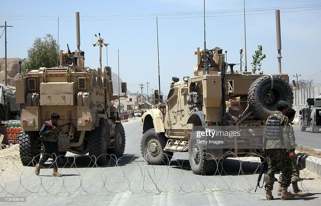 Afghan soldiers secure the road outside Kandahar Prison following the mass escape by inmates on April 25 2011 in Kandahar Afghanistan Over 450...