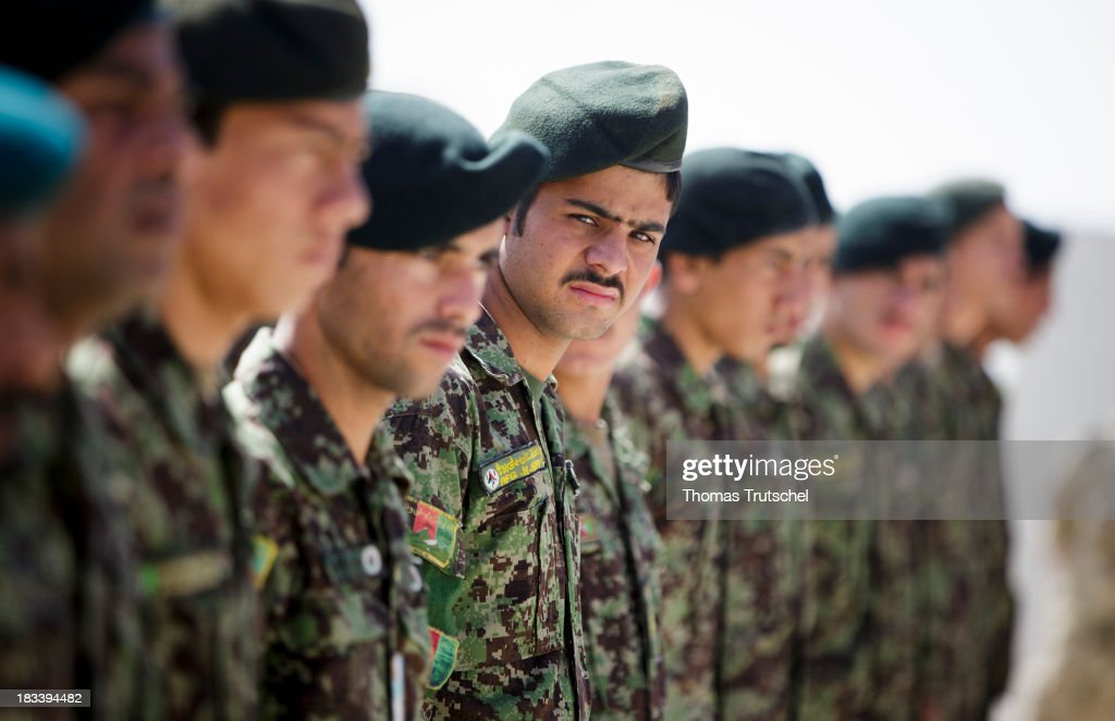 Afghan Soldiers stand in a line during a ceremonial handover at PRT Kunduz on October 06, 2013 in Kunduz, Afghansitan. Westerwelle and de Maiziere visit Afghanistan to hand over German PRT in Kunduz to the Afghan Military.