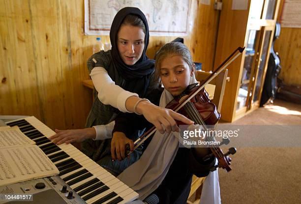 Afghan student Marjan Fidaye gets violin instruction from Allegra Boggess an American volunteer teacher from DenverColorado at the Afghanistan...