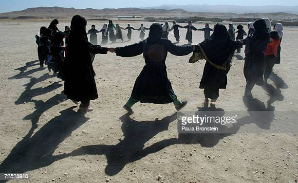 Afghan students from the Chagcharan girls school play games after classes October 22 2002 in Chagcharan located in central western Afghanistan At an...
