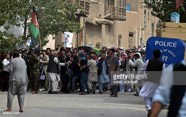Afghan supporters of the King Habibullah Kalakani clash with loyalists of vicepresident general Abdul Rashid Dostum during a burial ceremony at The...