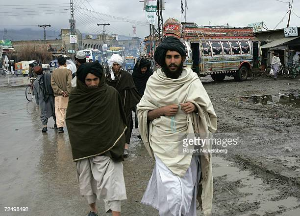Afghan Taliban walk through one of the main bazaars February 25 2005 in Quetta Pakistan Taliban forces have been taking refuge inside the bordering...