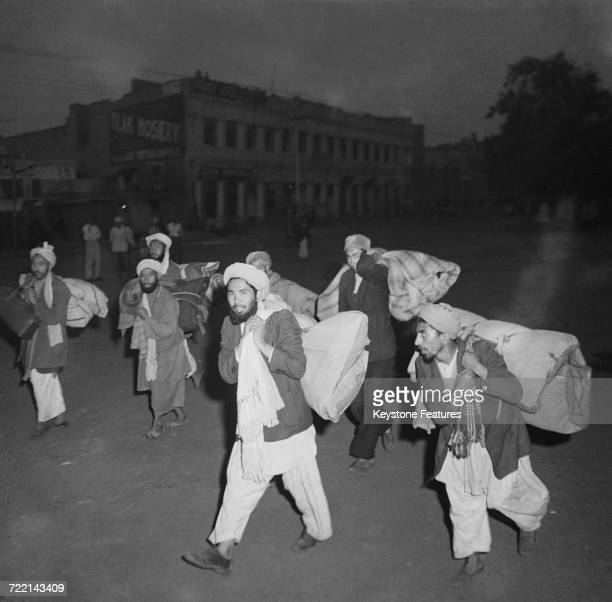 Afghan traders leaving Amritsar Punjab with all their belongings after communal violence in the city during the Partition of British India March 1947...