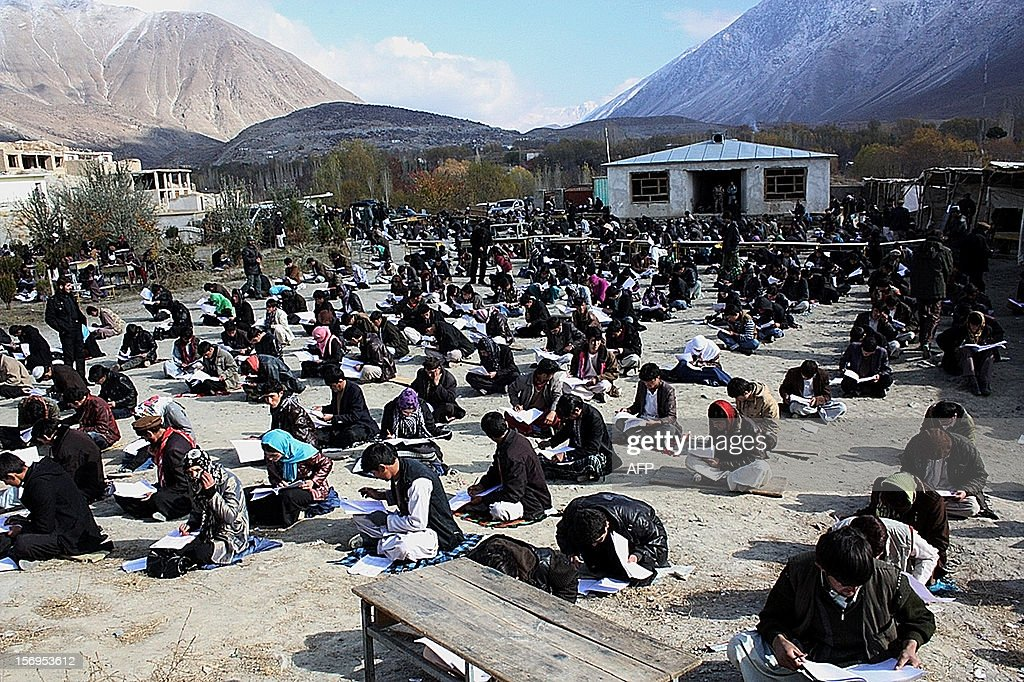 Afghan university students attend an exam in Baharak district in Badakhshan province on November 25, 2012. Afghanistan has closed down three major public universities in the capital Kabul for more than a week after sectarian clashes left one student dead and nearly 30 others wounded, an official said. The clashes erupted on November 24 after a ritual marking the Shiite Muslim festival of Ashura was interrupted by Sunni students. AFP PHOTO/ Sharif Shayeq