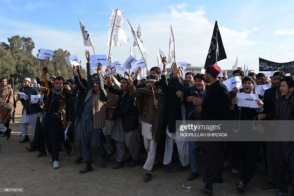 Afghan university students chant slogans during a protest against the printing of satirical sketches of the Prophet Muhammad by French magazine Charlie Hebdo in Jalalabad on January 18, 2015. Hundreds of Afghan university students demonstrated against the satirical Magazine Charlie Hebdo and its publication of cartoons depicting the Prophet Muhammad.