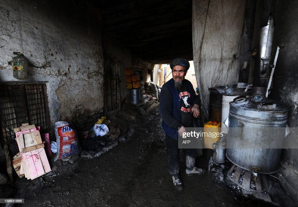 Afghan vendor Sharaf, 70, makes tea to sell to labourers in Mazar-i-Sharif in Balkh province on December 22, 2012. Once known as the 'mother of cities,' the ancient city of Balkh was a popular destination along the ancient Silk Route. Balkh was destroyed by Mongol conqueror Genghis Khan during his rule, with the city's ruins remaining as a tourist attraction today. AFP PHOTO/ Qais Usyan