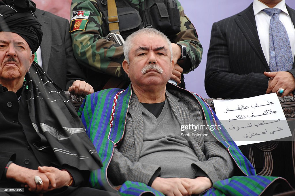 Afghan Vice Presidential Candidate Gen. Rashid Dostum sits at a rally for his presidential running mate Ashraf Ghani Ahmadzai at a rally for thousands of supporters at the Ghazi stadium on April 1, 2014 in Kabul, Afghanistan. Mr. Ghani is a frontrunner in the April 5 vote to succeed President Hamid Karzai, in an election that is seen as a test of stability that will ensure continued Western donor aid for a nation torn by a Taliban insurgency. The Ghazi stadium is known as the site of amputations and executions during Taliban rule in the late 1990s.