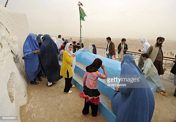 Afghan visitors gather and pray at a shrine on the ruins of the ancient city of Balkh located outside the northern Afghan town of MazariSharif on...