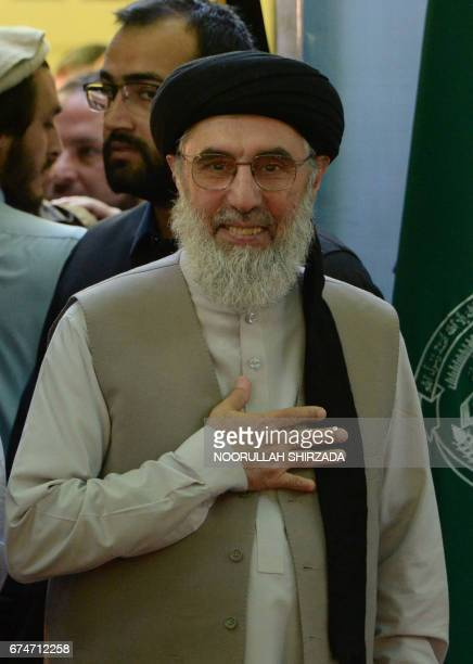 Afghan warlord and exprime minister Gulbuddin Hekmatyar gestures as he greets supporters at a rally in Laghman province on April 29 2017 Hekmatyar...