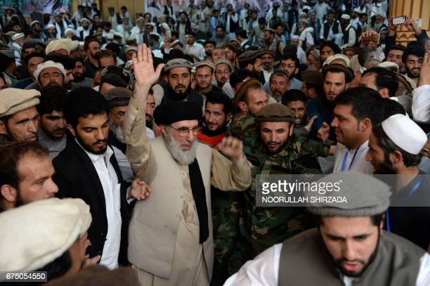 Afghan warlord and exprime minister Gulbuddin Hekmatyar gestures as he arrives at a rally in Jalalabad the capital of Nangarhar province on April 30...