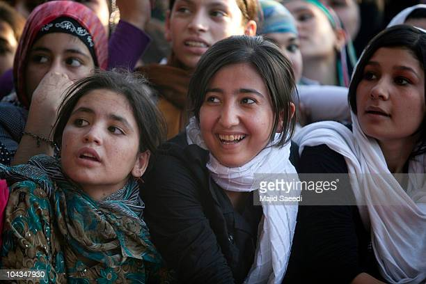 Afghan woman attend a concert during a peace day event on September 21 2010 in MazareSharif Balkh province north of Kabul Afghanistan Singer composer...