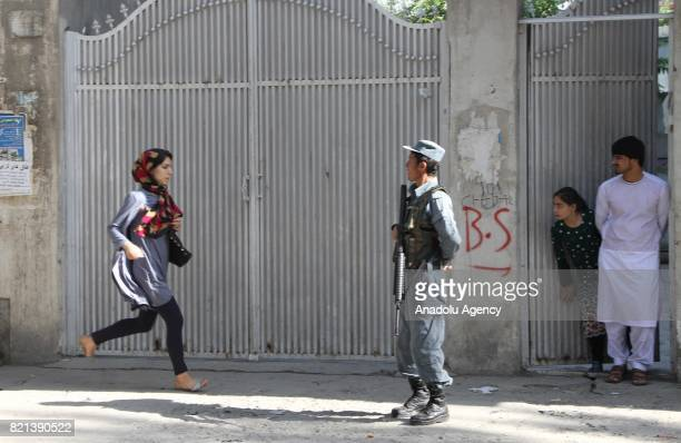 Afghan woman runs a way after a Suicide attack in Kabul Afghanistan on July 24 2017