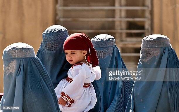 Afghan women arrive to cast their votes at a polling station in Kabul on September 18 2010 Afghanistan was voting for a new parliament September 18...