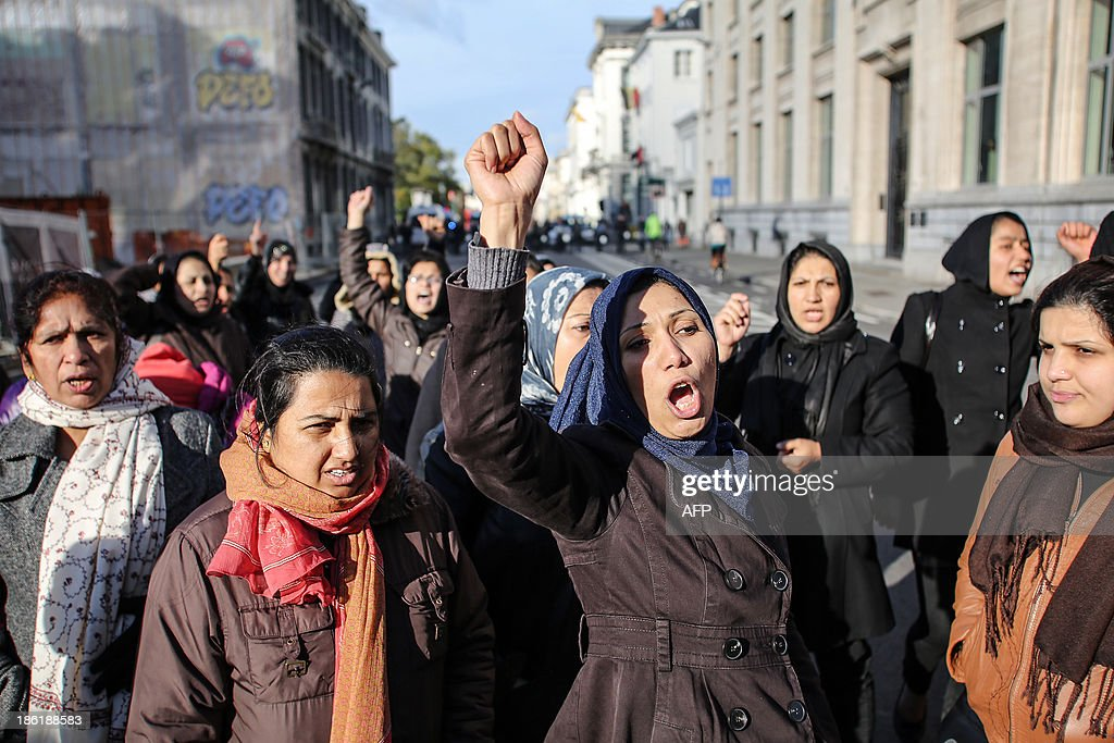 Afghan women chant slogans during a demonstration of Afghan refugees on the Wetstraat - rue de la Loi in Brussels on October 29, 2013.