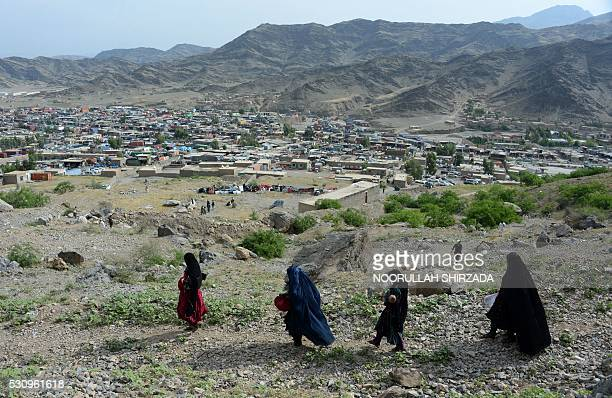 Afghan women cross the Torkham border between Afghanistan and Pakistan through the Shamshad mountains in Nangarhar province on May 12 2016 Torkham...