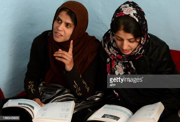 EDUCATION Afghan women gets literacy through mobile BY Mushtaq Mojaddidi Afghan women sit in a class and study in a new program that also uses mobile...