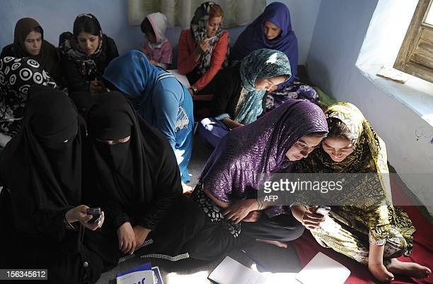 EDUCATION Afghan women gets literacy through mobile BY Mushtaq Mojaddidi Afghan women sit in a class and study using mobile phones in Kabul on...