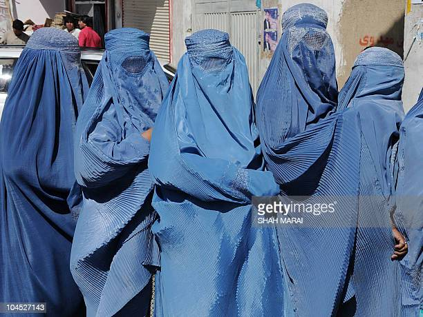 Afghan women line up to cast their vote outside a polling station in Kabul on September 18 2010 Afghanistan was voting for a new parliament September...