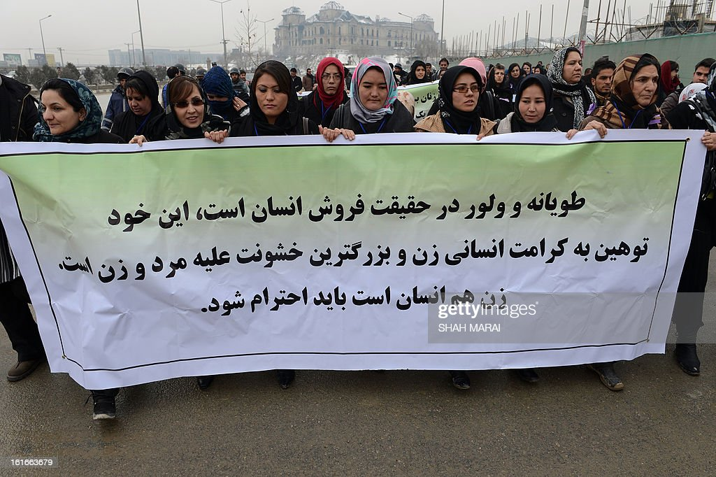 Afghan women march during a protest calling for an end to violence against women in Afghanistan and around the world, in Kabul on February 14, 2013. According to a UN report, Afghanistan has made progress in protecting women against violence, but many still suffer horrific abuse 11 years after a US-led invasion brought down the Taliban regime. Afghan women still endure killings by relatives in the name of family honour, forced marriages and domestic abuses. AFP PHOTO/SHAH Marai