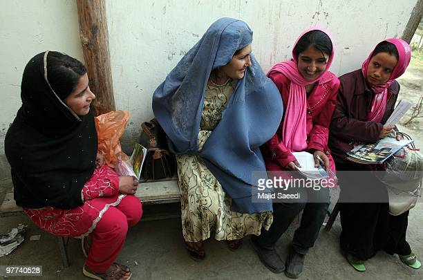 Afghan women meet on the second day of a polio vaccination campaign on March 15 2010 in Kabul Afghanistan The Public Health Ministry UNICEF and the...