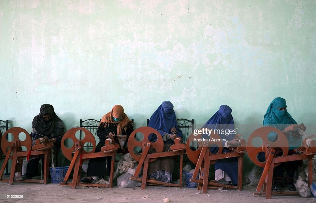Afghan women take part in the process of the carpet manufacturing on November 18 2013 in Balkh Afghanistan Afghan women working within a programme...